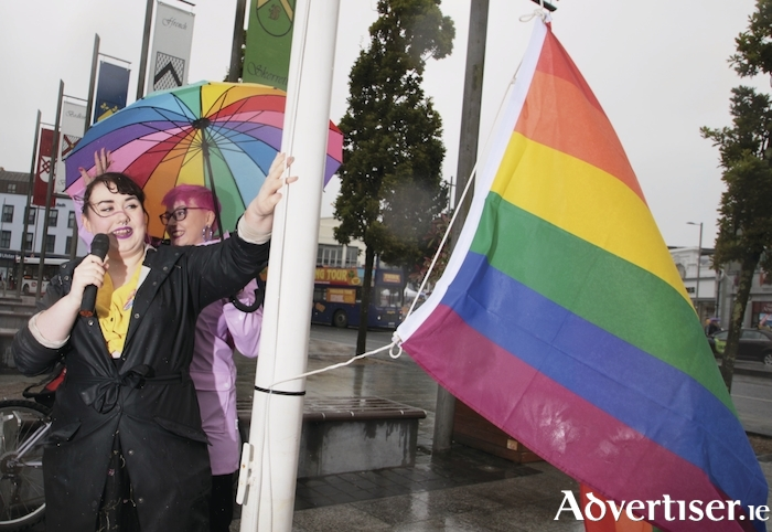 Sharon Nolan, chair of Galway Pride, hoists the Rainbow Flag on Tuesday at Eyre Square to officially start Galway Pride LBGTI+ Community festival which runs until Sunday. Photo:- Mike Shaughnessy Photo from the Pride Awards by John Crowley.