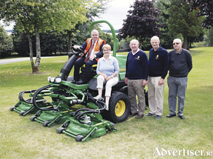 Deputy Kevin 'Boxer' Moran TD takes the specialised rough mower for a test drive at Athlone Golf Club.  He is pictured with Lady Captain Margaret Egan, Course Manager, Denis Earley, Kevin Newcomen and Micheal O'Faolain.