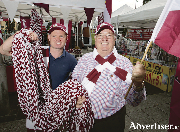 Ciaran and Gerry Devaney, who have been selling Galway flags, bunting and hats in the glorious maroon and white for fifty four years at their stall in Eyre Square, are hoping there will be some flags left for Liam MacCarthy's return on Monday.  Photo: Mike Shaughnessy
