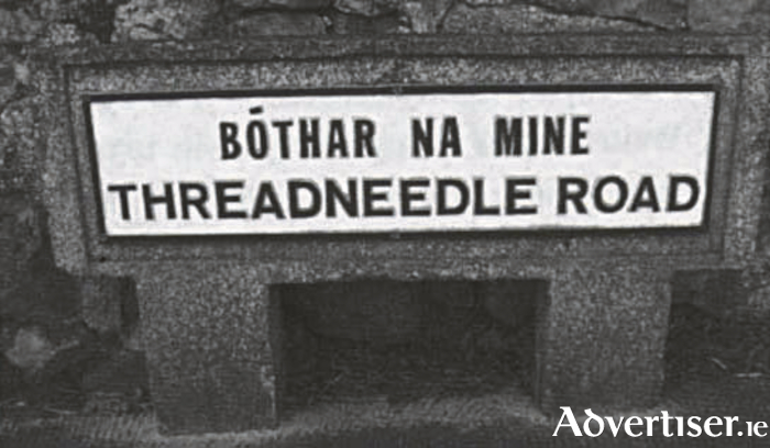 Grattan Road, but note its Irish name: Bóthar na Ndeich Bpinn, a 'ten-penny-a- day road' paid to the men who built it.
