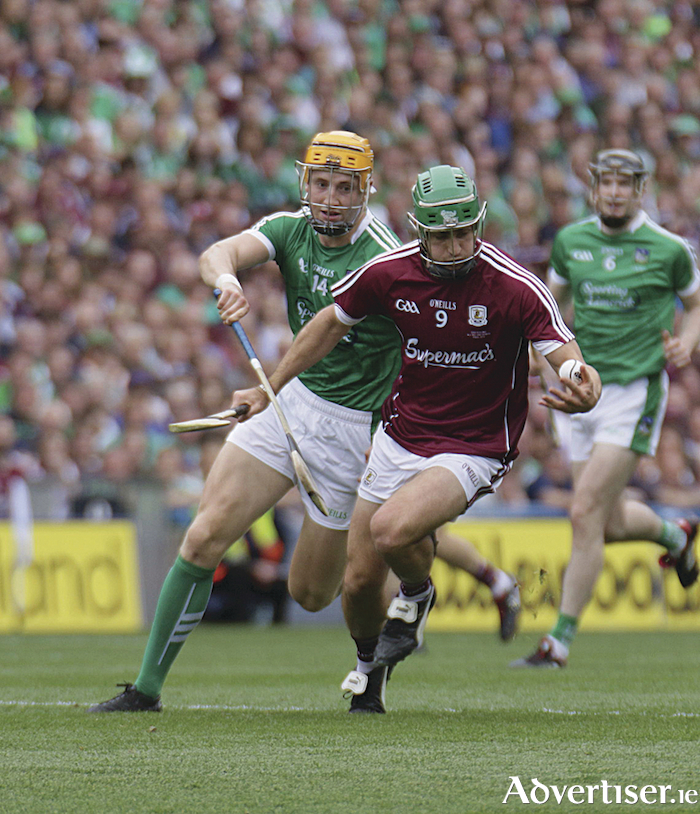Galway's David Burke and Limerick's Séamus Flanagan in action from the GAA Hurling All  Ireland Senior Championship final in Croke Park, Sunday. Photo:-Mike Shaughnessy