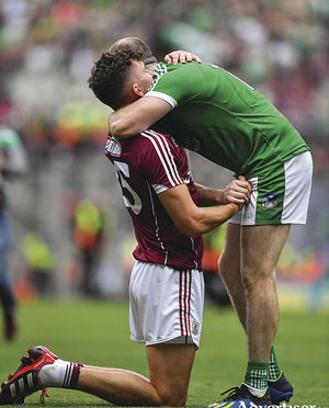 Sporting gestures are a winner: Jason Flynn of Galway is consoled by Tom Condon of Limerick following the GAA Hurling All-Ireland Senior Championship final  between Galway and Limerick at Croke Park in Dublin.