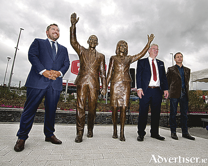 Pictured at the Barack Obama Plaza, Moneygall, are the former president's chief speechwriter, Cody Keenan, Supermac's MD, Pat McDonagh, and sculptor Mark Rode. Mr Keenan officially unveiled a Mark Rode statue of the former president and first lady, Barack and Michelle Obama. PHOTO:  Michael Dillon