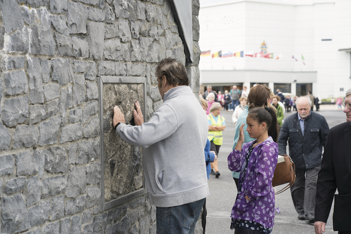 A pilgrim prays at the Apparition Chapel in Knock during the annual Novena. Photo: Michael McLaughlin