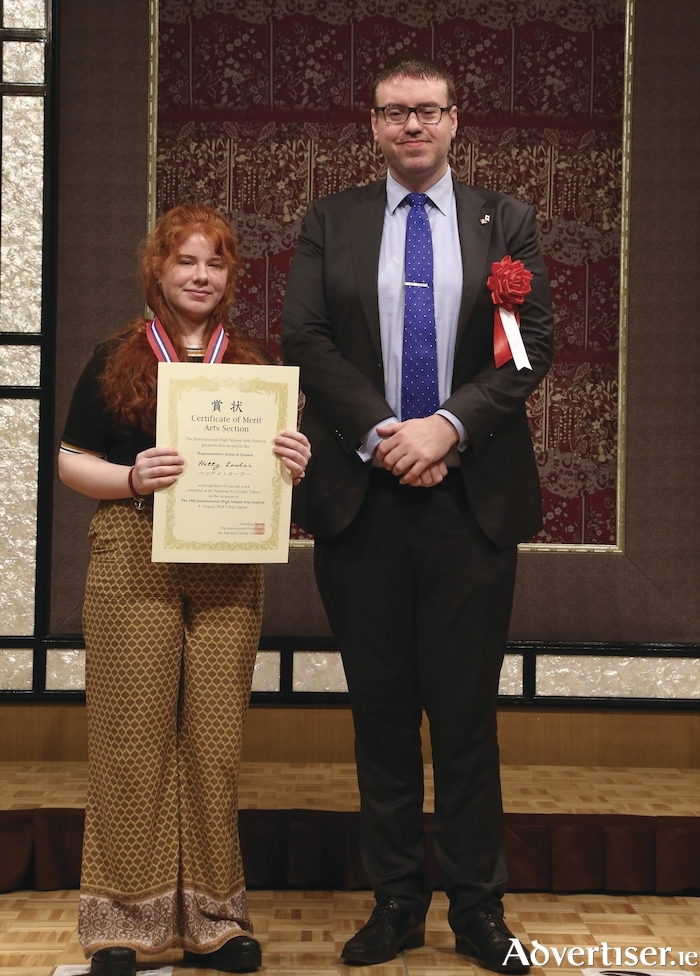 Hetty Lawlor is pictured in Japan attending an exhibition in Tokyo at which her prize-winning entry in this year's 64th Texaco Children's Art Competition is displayed. With her is Jonathan Patchell, Chargé d'Affaires ad interim, Embassy of Ireland, Tokyo.