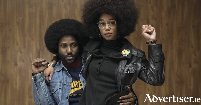 John David Washington and Laura Harrier in BlacKkKlansman.
