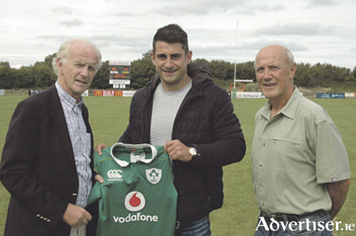 Connacht and Ireland's Tiernan O'Halloran presents his national jersey to Buccaneers President Tom Meagher.  Also pictured is Aidan O'Halloran.