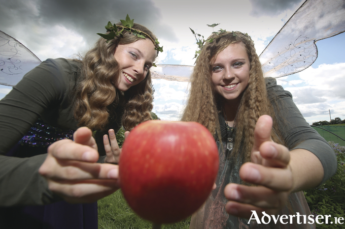 Saibh and Imogen Malcolm from Headford celebrating The Moveable Feast, a special new festival honouring the humble apple, which will take place in the beautiful Headford Community Garden on 9 September. Photograph by Aengus McMahon