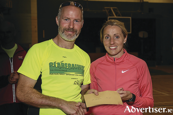 Brendan Dunleavy of The Arches Claregalway, main race sponsor, with winner Regina Casey.