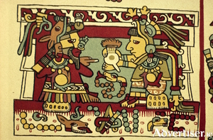 A drawing of a Mesoamerican couple drinking chocolate upon marriage.An Aztec couple drinking a foamy cacao drink on their wedding day.