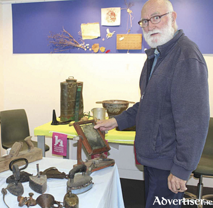 James Dobbie surveys the artefacts on display during Heritage Week 2018.