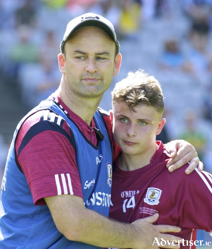 Galway manager Donal Ó Fátharta consoles forward Daniel Cox iafter losing to Kerry in the All Ireland minor final at Croke Park, Sunday. 			Photo:-Mike Shaughnessy
