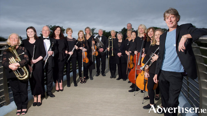 A section of Mayo Concert Orchestra attend the launch for the Sean Keane tour with the singer at Lough Lannagh Bridge in Castlebar. Photo: Alison Laredo