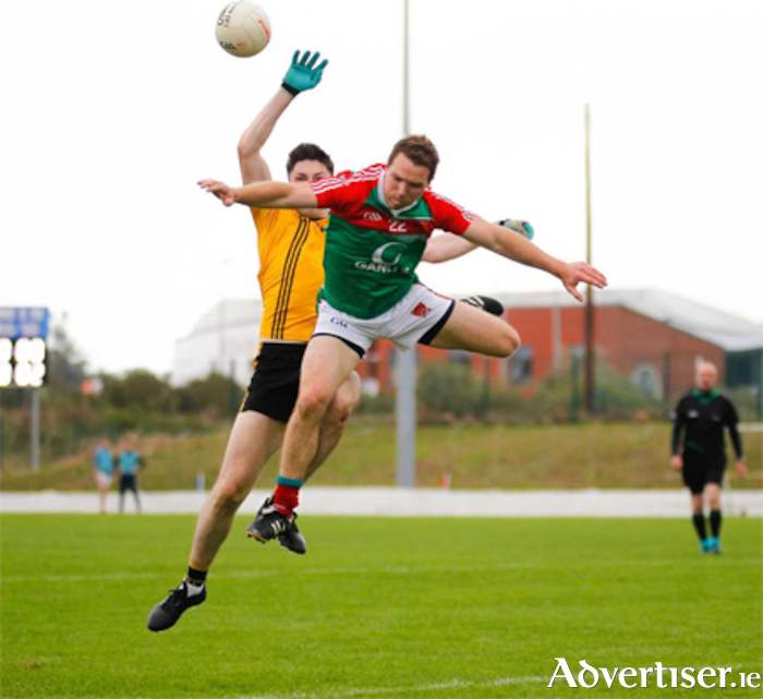 John Gaffey of Garrycastle goes sky high against Rosemount in the Westmeath SFC.  Photo by AC Sports Images.