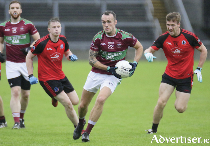 St James' Davis O'Connell goes on the attack, chased by Jack Ó Gaoithín and Cillín de Paor of  An Cheathrú, in action from the Galway Senior Club Football Championship game at Pearse Stadium, Saturday. Photo:-Mike Shaughnessy