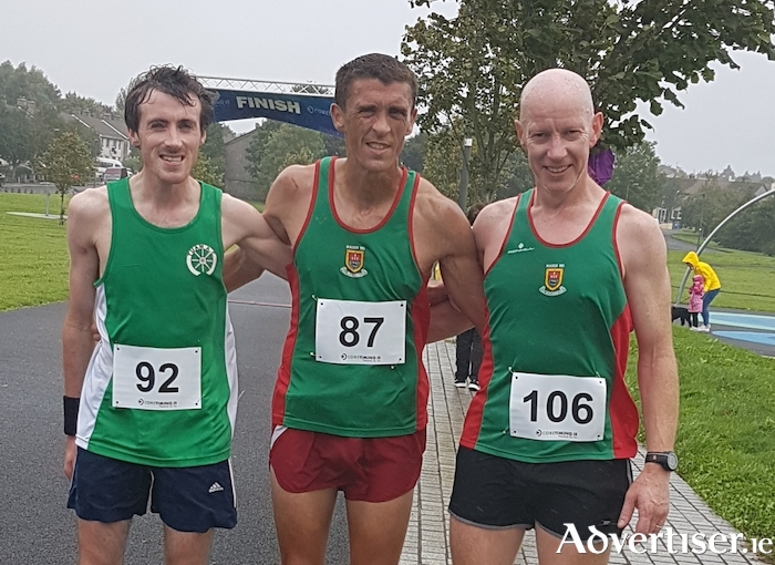 Top three finishers in the Castlebar Greenway 10 mile race: Daire Comer (Tuam AC) 3rd, John Byrne (Mayo AC) 1st and David Tiernan (Mayo AC) 2nd.
