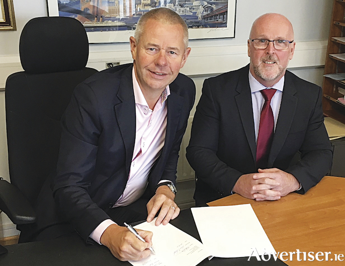At the announcement of the appointment is Western Motors managing director, James McCormack (left) with David Smith, after-sales manager for Mercedes-Benz commercial vehicles.