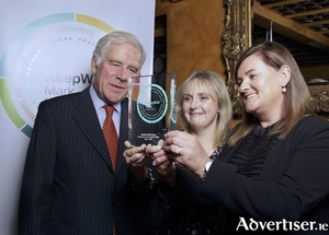 John Brennan of IBEC presents the The KeepWell Mark award to Aisling Dudley and Siobhan Howley of Callanan Hotel Group. 