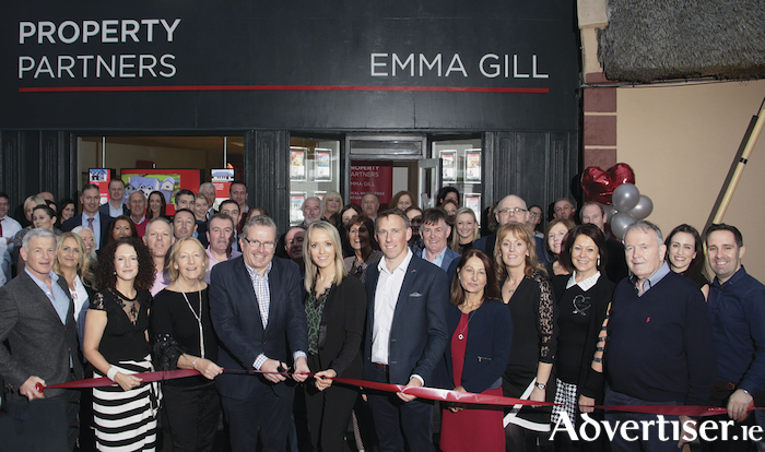 Emma Gill and Phillip Farrell, property consultant, Property Partners Real Estate Group, along with supporters at the opening of Property Partners Emma Gill's new Galway office in Clarinbridge on Friday. Photo: Mike Shaughnessy.