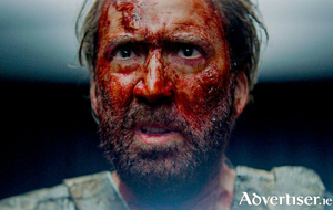 A bloody but unbowed Nicholas Cage.
