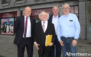 Uachtarán na hÉireann Michael D Higgins pictured with Galway Advertiser editor Declan Varley (left), managing director Peter Timmins (centre), and company chair Ronnie O'Gorman (right). Photo:- Mike Shaughnessy