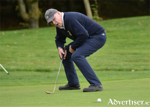 Declan Corcoran looks on as his putt veers towards the hole during the Pierce Purcell Shield final at Thurles Golf Club