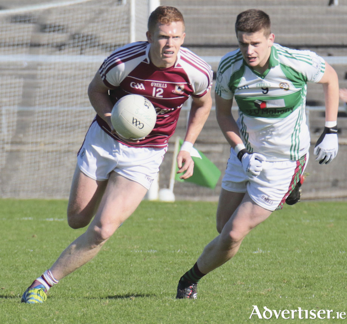 Annaghdown's Ciaran Duggan and St James' Aaron Connolly in action from the Galway Senior Football quarter-final at Pearse Stadium on Saturday. 	Photo:-Mike Shaughnessy