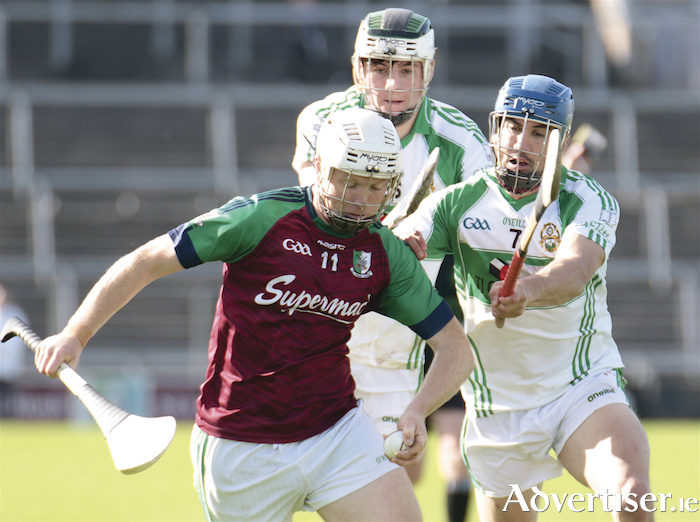 Castlegar's Luke Lynskey and David Skehill puts pressure on Kilimor Daly's Gerard Farragher in action from the Senior Club Hurling championship clash at Pearse Stadium on Sunday.  Photo:-Mike Shaughnessy
