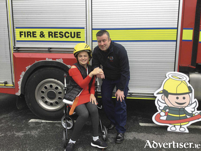 Mia Samovich (Sunshine Club) and Joe Feery (Fire Fighter, Athlone Fire & Rescue) at the IWA 'Angel's campaign launch