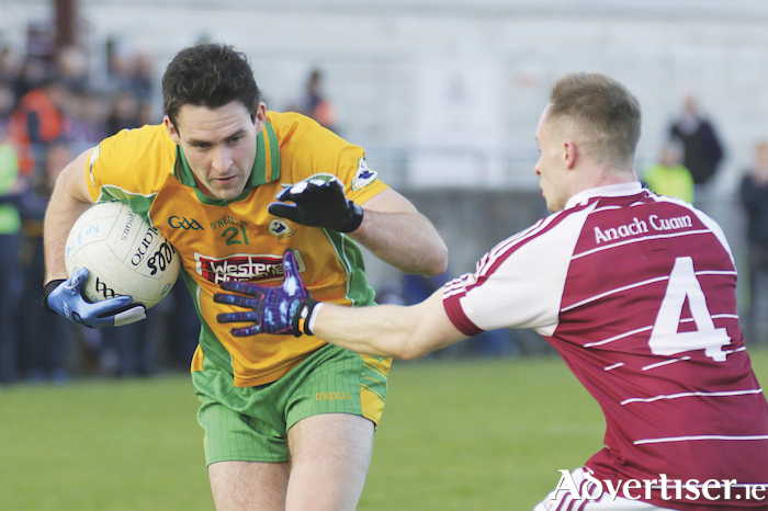 Corofin's Mike Farragher - a candidate to  man the engine room this weekend, and Annaghdown's Joe Kevin in action from the Galway Senior Football Championship clash at Tuam Stadium, Sunday. Photo:-Mike Shaughnessy