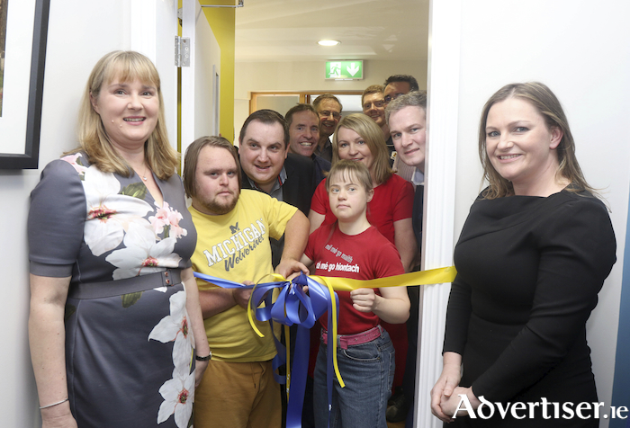 Roisin De Burca and Fionn Cronbie Angus cut the ribbon to officially open the new resource centre for the Galway Branch of Down Syndrome Ireland in Moycullen.