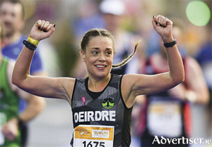 Deirdre Keena, Moate Athlone Running Group, in jubilatory mode, as she crosses the finish line at the Dublin City Marathon