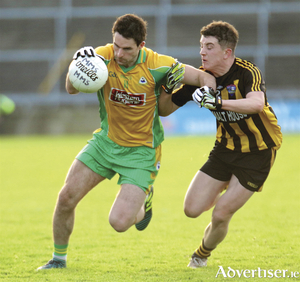 Corofin's Michael Farragher and Mountbellew-Moylough's Mark Mannion in action from the Galway Senior Club Football final at Pearse Stadium, Sunday. Photo:-Mike Shaughnessy