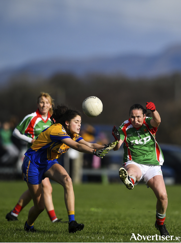 Michelle McGing clears her lines for Carnacon in the county senior final against Knockmore. Photo: Sportsfile