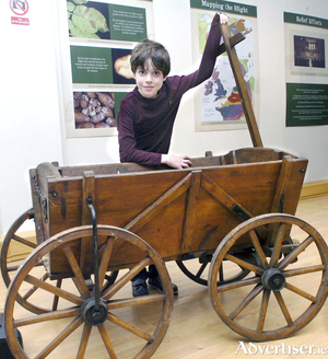 A relic of famine times - young Lochlainn Sweeney proudly displays a Goat Cart synonymous with famine times at the opening of the Ballina Lions Famine Exhibition. The antique goat cart was a gift to his grandparents Ruth and Adrian Bourke from their beloved local antique dealer Billy Sommerville in the hope it's historical heritage would be preserved and is now just one of the outstanding exhibits in the Ballina Lions Club Famine Exhibition. Photo: Henry Wills