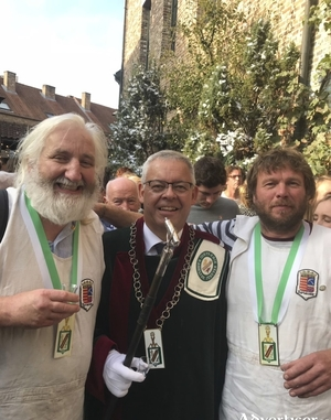 Peter Jaenen, Master of Ceremonies at the Jeneverfest in Belgium with the newly knighted Cillian Ó Móráin (left) and Bart Adons of Mescan Brewery.