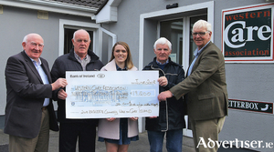 Members of the Clare Island Walking Committee, Tom Cusack, Pat and Nicki Conneely and Willie Murphy, presenting a cheque for €19,200, the proceeds of the 2018 Kathleen Conneely Memorial Charity Walk on Clare Island for Western Care Association, to Joe Brett, Fundraising Manager, WCA.