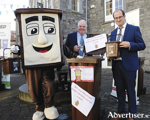 Cllr John Dolan, Cathaoirleach, Westmeath County Council, and Cllr Paul Hogan with 'Benny' the Brown Bin.