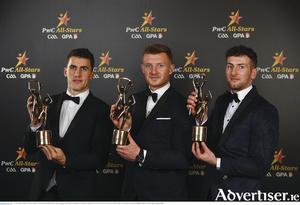 Galway hurlers Daithi Burke, Joe Canning, and Padraic Mannion with their All-Star awards at the PwC All Stars 2018 at the Convention Centre in Dublin. 