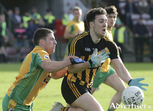 Dylan Wall of Corofin tackles Eoin Finnerty of Mountbellew Moylough in action from the Galway Senior Club Championship Football final at Pearse Stadium on Sunday. Photo:-Mike Shaughnessy