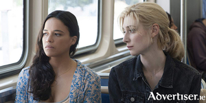 Michelle Rodriguez and Elizabeth Debicki in Widows.