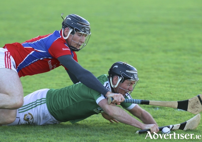 Fallen champion - Liam Mellow's Conor Hynes comer under pressure from Shane Cooney of St Thomas' during the Galway Senior Club Hurling final at Pearse Stadium on Sunday. Photo:-Mike Shaughnessy