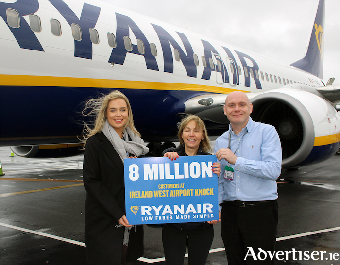 Robin Kiely, Ryanair, and Donal Healy, Ireland West Airport  present Irene Brady with her prize after being named the eight millionth Ryanair passenger at Ireland West Airport.