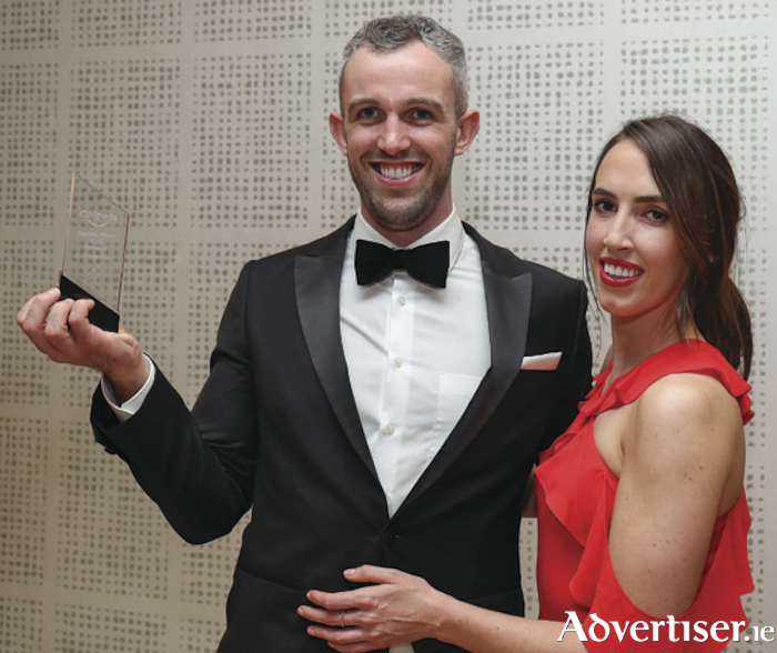 Dr James Flood, of Eyre Square Dental, Galway, with his partner, Claire O'Sullivan, with his Regional Winner 2018 Connacht award.