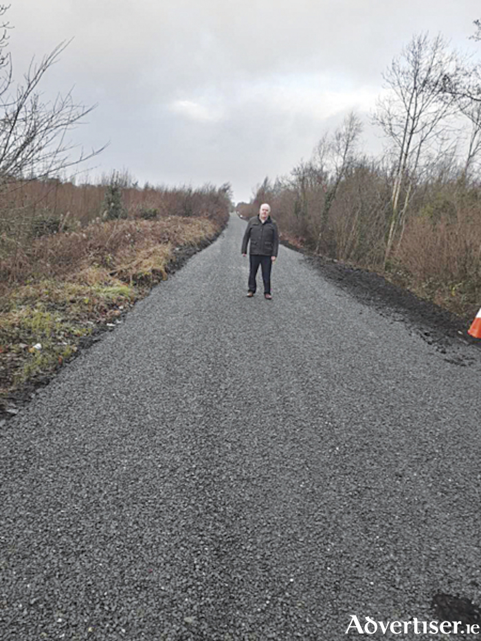 Cllr. John Dolan, pictured on the resurfaced Tully road