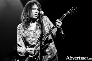Neil Young in concert in 1976.