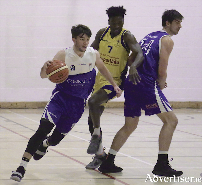 Maree's Eoin Rockall is chased by Killorgin's Pierre Newton in action for the Basketball Ireland Mens Superleague clash at Calasanctius College, Oranmore on Saturday.     Photo:-Mike Shaughnessy