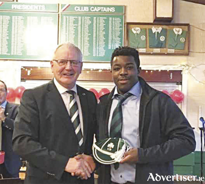 Liam Winnett receives his fifth Irish rugby international cap from IRFU President Ian McIlrath, his first at U19 level, following four appearances at U18 level.