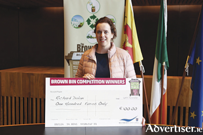 Carmel Dolan, wife of Richard Dolan, Castledaly, who was one of a number of winners who received their prizes at the Athlone Municipal District building.  Photograph by Moore Photography.