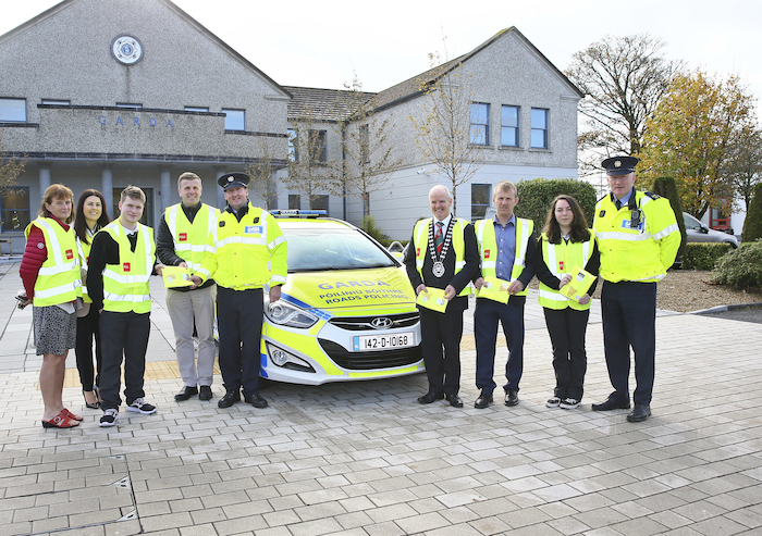 Pictured at handing over of High viz Vests from the Mayo Road Safety Office were from left: Marie Moran, Eilish Mulherin, Ethan Dixon, Neil Sheridan, Garda John Flanagan (Roads Policing), Cllr Blackie Gavin (Cathaoirleach Mayo County Council), Noel Gibbons (Roads Safety Office Mayo County Council) Reya Gitoler, and Garda Sean Cunnane (Roads Policing). Photo: Michael Donnelly